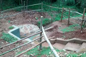 The Water Project: Wamuhila Community, Isabwa Spring -  Community Fenced In Their Spring