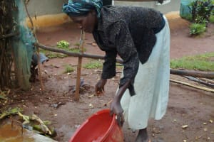 The Water Project: Wamuhila Community, Isabwa Spring -  Rebecca Sayo Demonstrates How Easy It Is To Clean The New Sanitation Platform