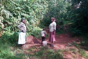The Water Project: Gidagadi Community, Anusu Spring -  Community Members By The Spring