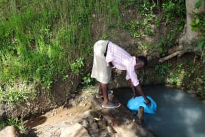 The Water Project: Luyeshe Community, Simwa Spring -  Jecinta Filling Her Jerrycan