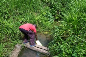 The Water Project: Abangi-Ndende Community -  Fetching Water