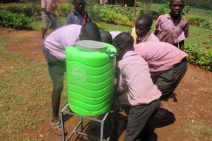 The Water Project: Lwangele Primary School -  Students Trying The Hand Washing Station During Training