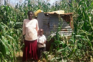 The Water Project: Mtao Community, Tifina Odari Spring -  Consolata And Her Son By Their Latrine