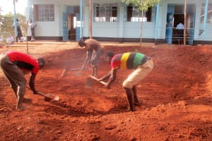 The Water Project: Digula Secondary School -  Community Members Helping Level The Ground For The Tank