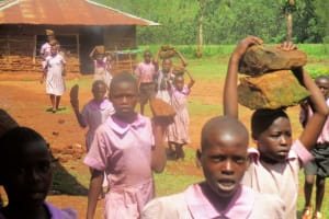 The Water Project: Lwangele Primary School -  Students Carrying Stones To The Artisans