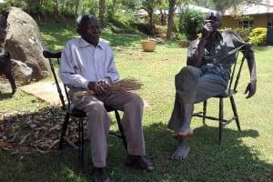 The Water Project: Irungu Community, Irungu Spring -  Mr Joshua Enima And Friend