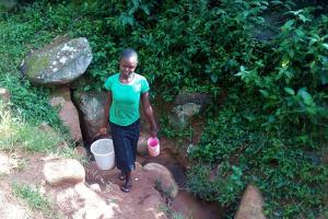 The Water Project: Gidagadi Community, Anusu Spring -  Fetching Water