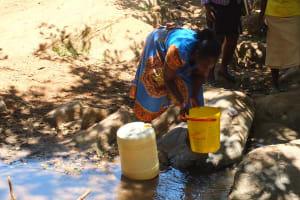 The Water Project: Chepkemel Community -  Fetching Water