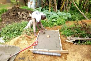 The Water Project: Chegulo Community, Shakava Spring -  Sanitation Platform Construction