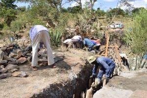 The Water Project: Ilinge Community -  Sand Dam Construction