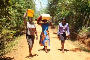 The Water Project: Chepkemel Community -  Carrying Water