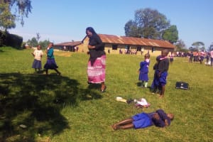 The Water Project: Musudzu Primary School -  Field Officer Karen Maruti Interacts With Pupils Before The Training