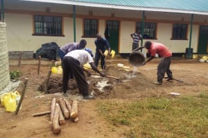 The Water Project: Eshilakwe Primary School -  Mixing Cement