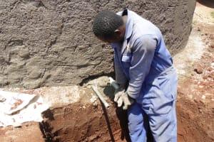 The Water Project: Ebukanga Secondary School -  Artisan Installing Discharge Pipe