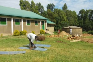 The Water Project: Ibinzo Girls Secondary School -  Artisan Making Gutters