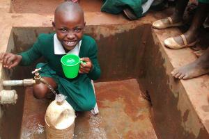 The Water Project: Emurembe Primary School -  Anastacia Ogutu Enjoys Water At The Tank