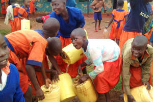The Water Project: Essunza Primary School -  Students Cleaning Their Containers