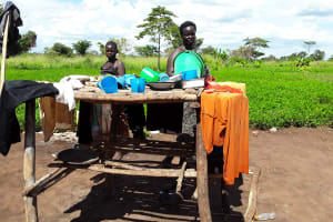 The Water Project: Katugo I-Alu Community -  Daugher And Mom Drying Dishes
