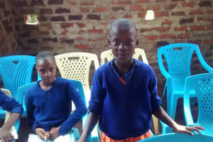 The Water Project: Essunza Primary School -  Student Responding To A Question In Training