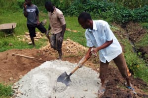 The Water Project: Bushevo Community, David Enani Spring -  Mixing Cement