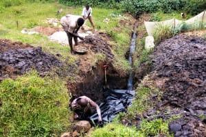 The Water Project: Bushevo Community, David Enani Spring -  Spring Foundation Construction