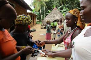 The Water Project: Kafunka Community -  Building Hand Washing Stations