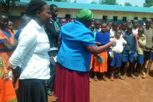 The Water Project: Essunza Primary School -  Sanitation Teacher Talking To Students