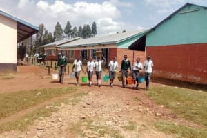 The Water Project: Tulon Secondary School -  Students Coming Back To School With Water