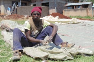 The Water Project: Ebukanga Secondary School -  Community Member Alex Helps Sew Sugar Sacks