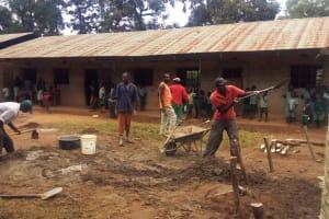 The Water Project: Eshilakwe Primary School -  Community Members Helping The Artisan