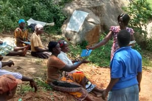 The Water Project: Lugango Community, Lugango Spring -  Handing Out Notebooks