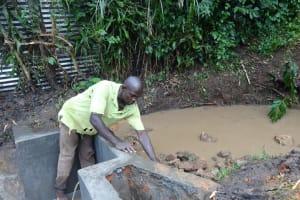 The Water Project: Shikhambi Community, Daniel Inganga Spring -  Backfilling