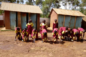 The Water Project: Shanjero Primary School -  Girls Washing Hands At Latrines