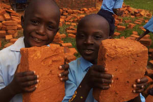 The Water Project: Mumias Central Primary School -  Students Carrying Bricks