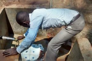 The Water Project: Lugango Community, Lugango Spring -  Training On Spring Maintenance