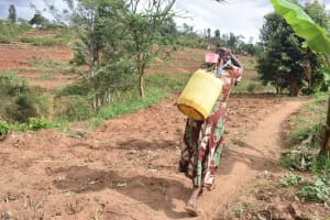 The Water Project: Kyumbe Community A -  Carrying Water