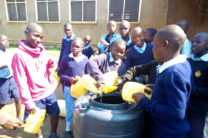 The Water Project: Mumias Central Primary School -  Students Delivering Water