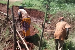 The Water Project: Lugango Community, Lugango Spring -  Participants Dug Spring Drainage Before Leaving Training