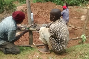 The Water Project: Lugango Community, Lugango Spring -  Building A Fence