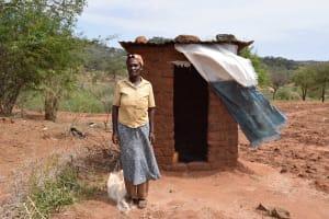 The Water Project: Nzalae Community A -  Tabitha Munywoki At Her Latrine