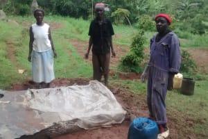 The Water Project: Lugango Community, Lugango Spring -  Sanitation Platform Construction