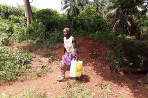 The Water Project: Rwentale-Kyamugenyi Community -  Carrying Water