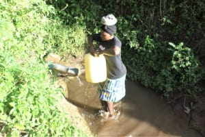 The Water Project: Emusanda Community, Walusia Spring -  Carrying Water
