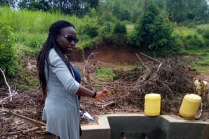 The Water Project: Timbito Community, Atechere Spring -  Field Officer Christine Luvandwa At The Spring