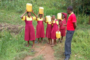 The Water Project: Shanjero Primary School -  Carrying Water