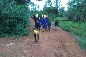 The Water Project: Iyenga Primary School -  Carrying Water