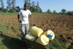 The Water Project: Emusanda Community, Walusia Spring -  A Young Man On His Way To Get Water