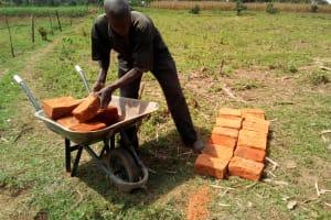 The Water Project: Mukhuyu Community, Shikhanga Spring -  Man Delivering Bricks
