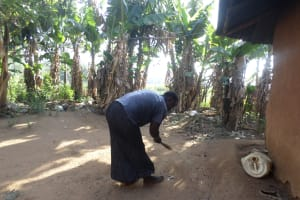 The Water Project: Emusanda Community, Walusia Spring -  Woman Cleaning Her Compound