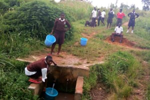 The Water Project: Mwitoti Secondary School -  Fetching Water From The Spring